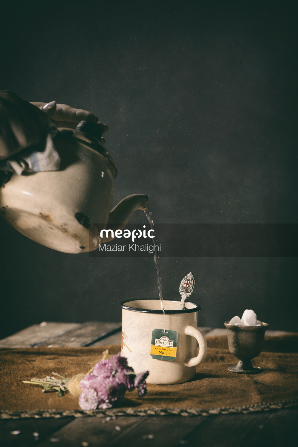 Cup Of Coffee And A Vase Of Flowers On A Table Stock Photo · Meapic