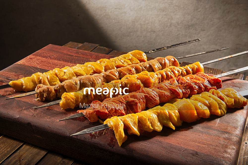 Row Of Food On A Wooden Table Stock Photo · Meapic
