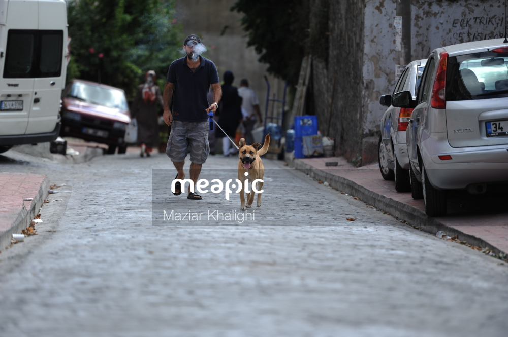 Man Walking Down The Street Stock Photo · Meapic