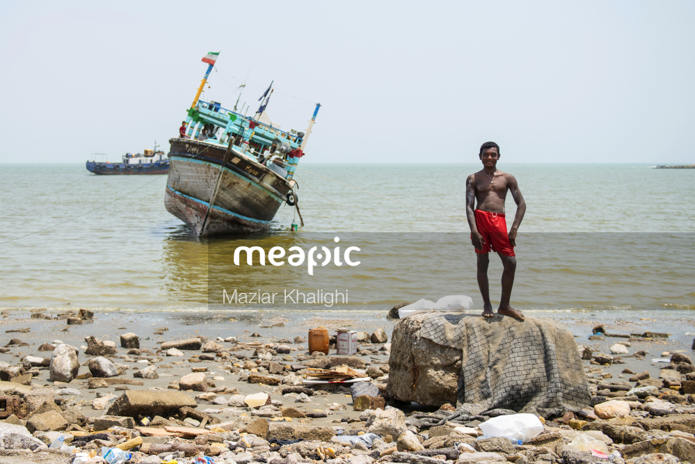 Man Standing On A Rocky Beach Stock Photo · Meapic