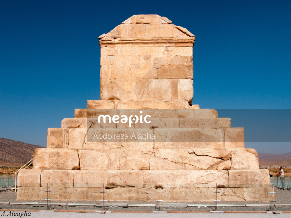 Large Stone Building With A Clock Tower With Pasargadae In The Background Stock Photo · Meapic