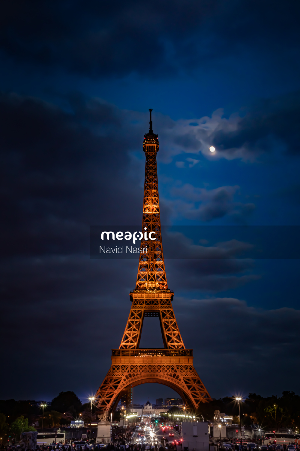 Clock Tower Lit Up At Night With Eiffel Tower In The Background Stock Photo · Meapic