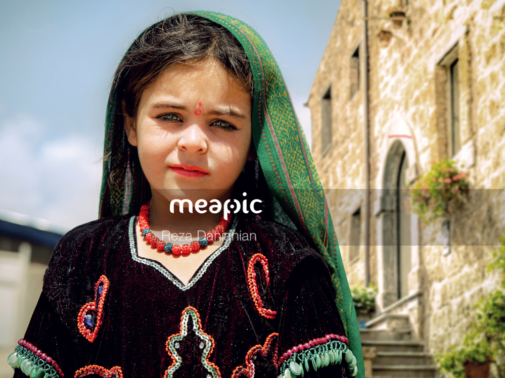 Little Girl Standing In Front Of A Building Stock Photo · Meapic