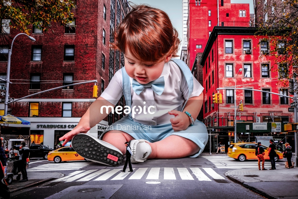 Little Boy That Is Sitting In The Middle Of The Street Stock Photo · Meapic