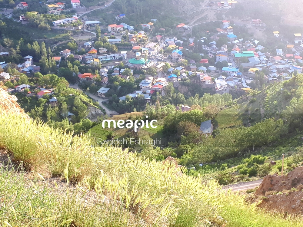 Group Of People Walking On A Grassy Hill Stock Photo · Meapic