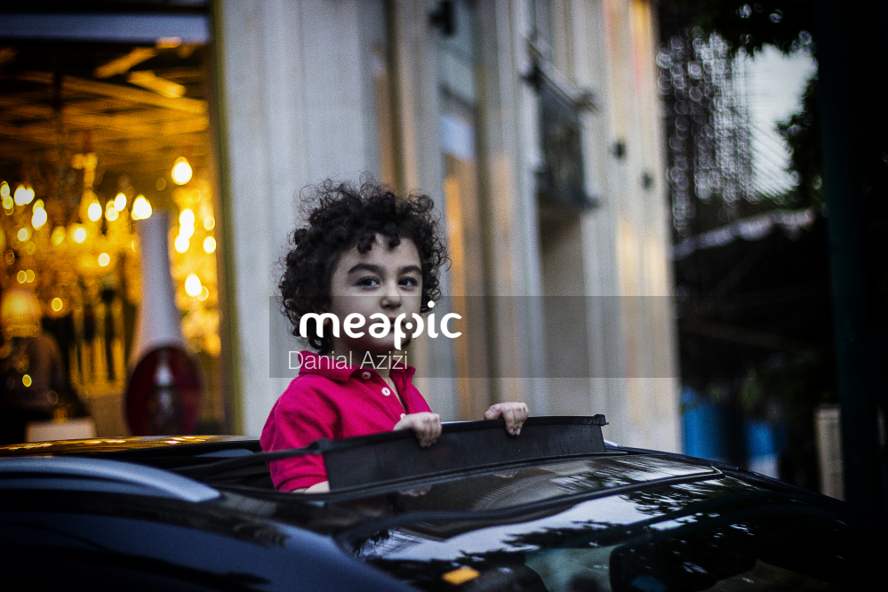 I Am Not Really Confident, But Young Boy Sitting At A Table Stock Photo · Meapic