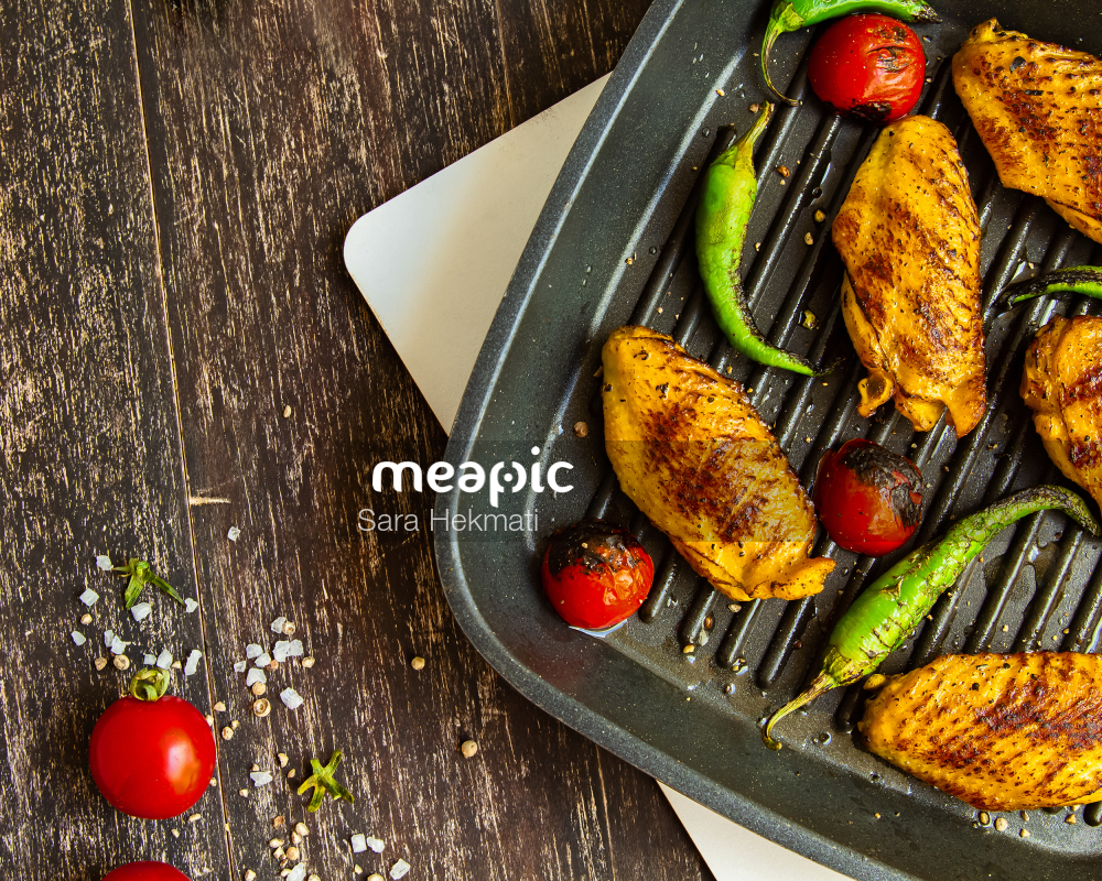 Plate Of Food On A Table Stock Photo · Meapic