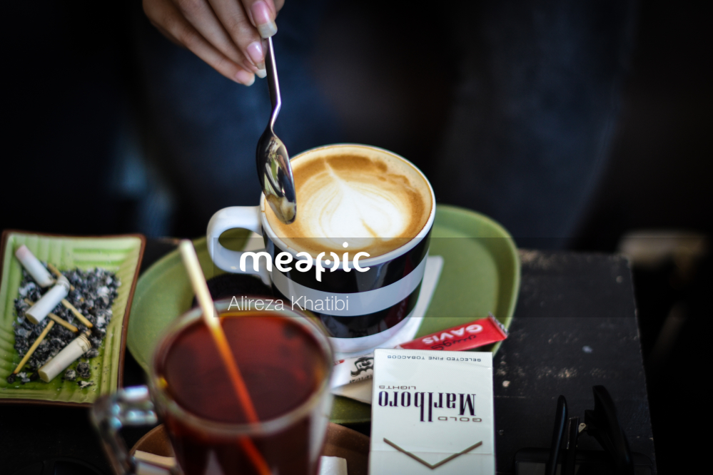 Cup Of Coffee On A Table Stock Photo · Meapic